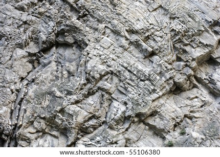 Stratified rocks in a cliff face - stock photo