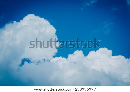 Stratocumulus clouds in the sky, split toning cross processed. - stock photo