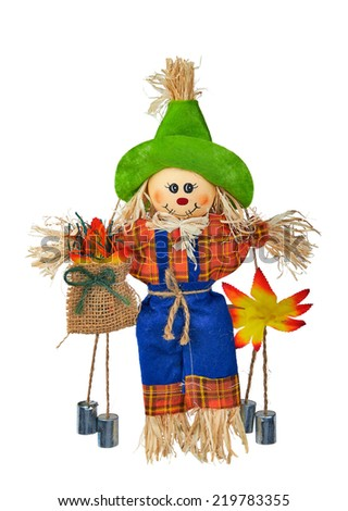 Straw and fabric scarecrow with smiling face for Halloween. Isolated on white background. - stock photo
