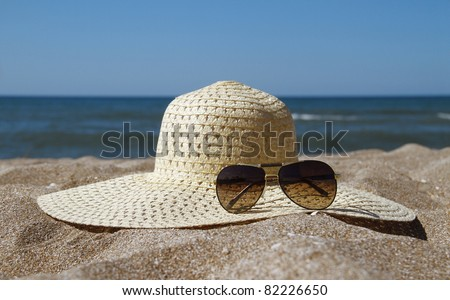 straw and sunglasses on the - stock photo