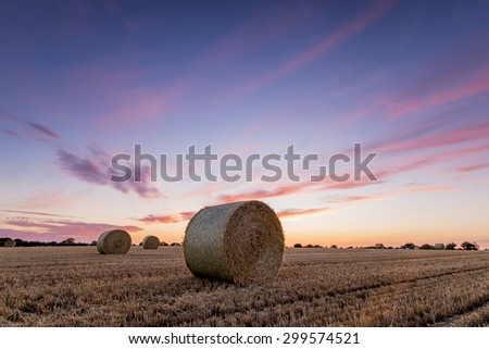 Straw Bales in a field at sunset on a summers evening.