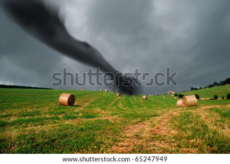 straw bales into the storm with tornado - stock photo