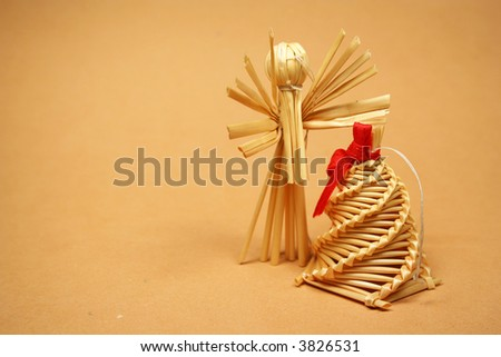 Straw doll and bell