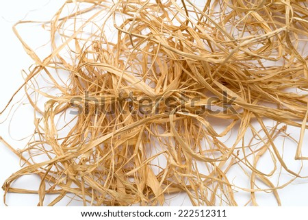 straw for packing and decorating on white background - stock photo