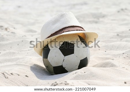 Straw Hat and Football on the Beach. Feeling relax.  - stock photo