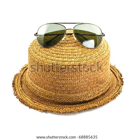 straw hat and sunglasses isolated on a white background - stock photo