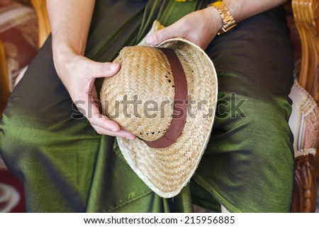 straw hat in the hands - stock photo