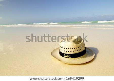 Straw Hat on beach - stock photo