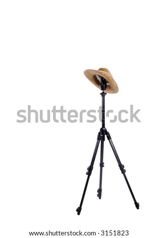 Straw hat on studio tripod isolated