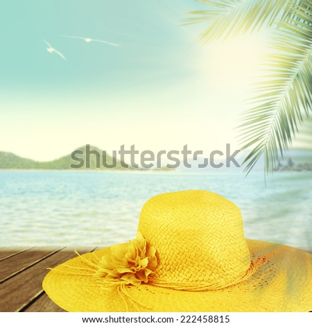 Straw hat on the beach. Vacation concept background. - stock photo