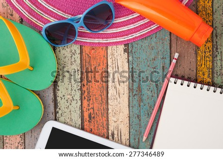 Straw hat tablet and sunglasses on vintage wood.Summer holiday background concept.Copy space. - stock photo