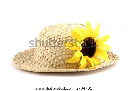 Straw hat with a bright yellow sunflower. - stock photo
