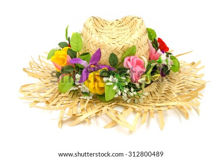 Straw hat with flower isolated on a white background. - stock photo