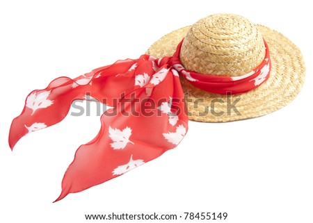 Straw hat with red shawl isolated over white