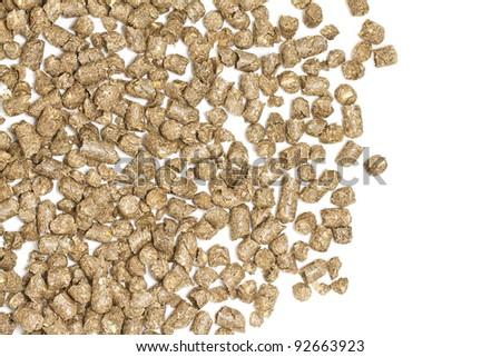 Straw pellets on white background - stock photo