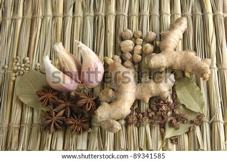 straw tied up by threads background of various spices