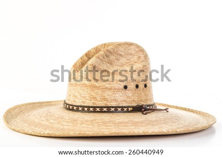 Straw Work Hat shaped in old fashioned High Peak Western Style.  White background with copy space. - stock photo