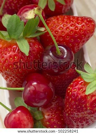strawberries and cherries - stock photo