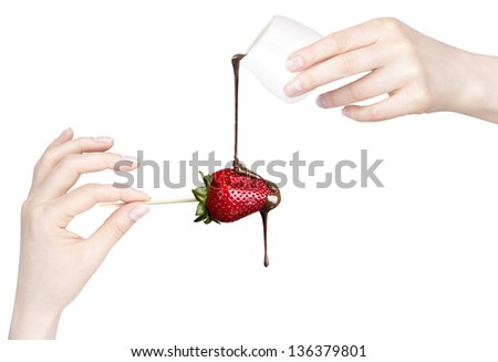 strawberries and chocolate with hand on a white background