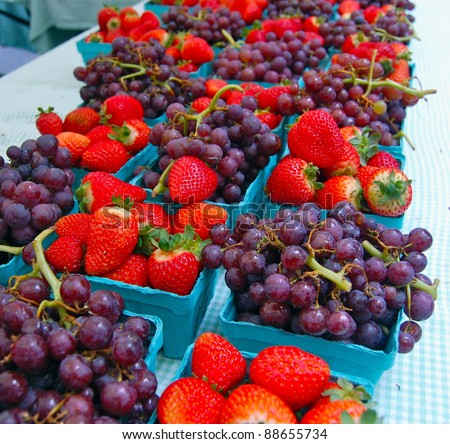 Strawberries and Grapes at Farmer's Market - stock photo