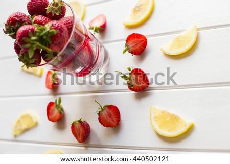 strawberries and lemon slices - stock photo