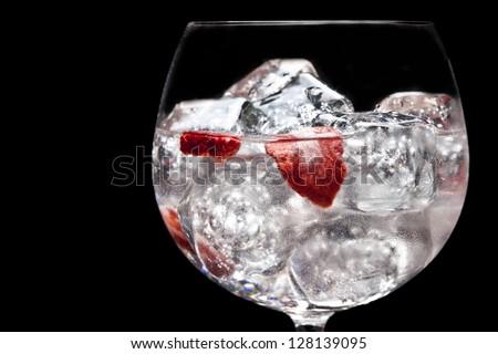 Strawberries and raspberries gin tonic - stock photo