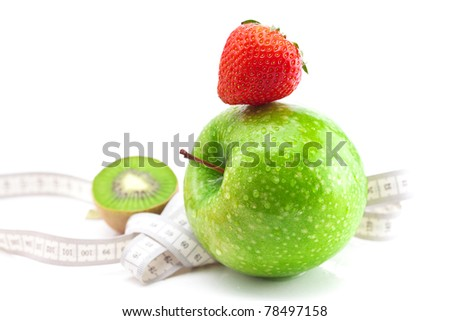 strawberries,apple with water drops,kiwi and measure tape isolated on white