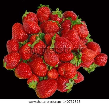 strawberries black background - stock photo