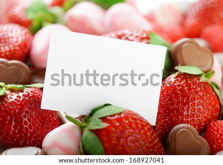strawberries,candy and chocolates  - stock photo