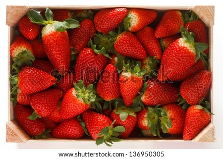 Strawberries clean and simple in wooden box