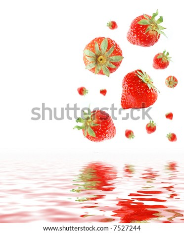 strawberries falling in water - stock photo