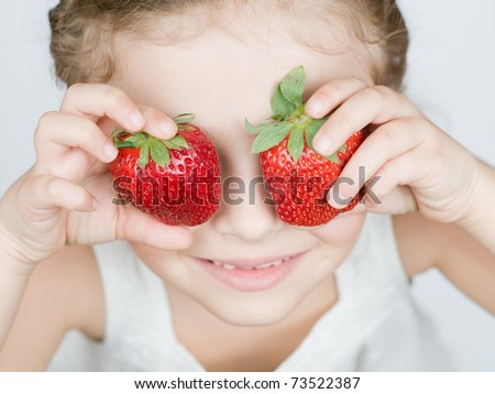 Strawberries - happy girl with strawberries - stock photo