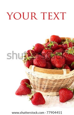 strawberries in a basket over white