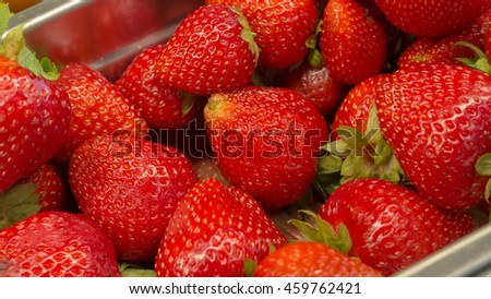 Strawberries in a metal box.