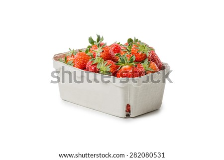 Strawberries in a paper bowl isolated on white background - stock photo