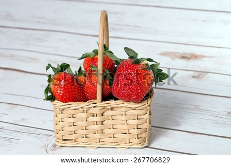 Strawberries in a small basket / Strawberries - stock photo