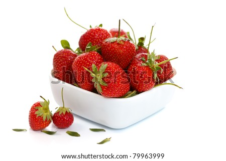 Strawberries in a white bowl, healthy food concept