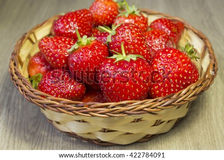 strawberries in a wicker plate - stock photo