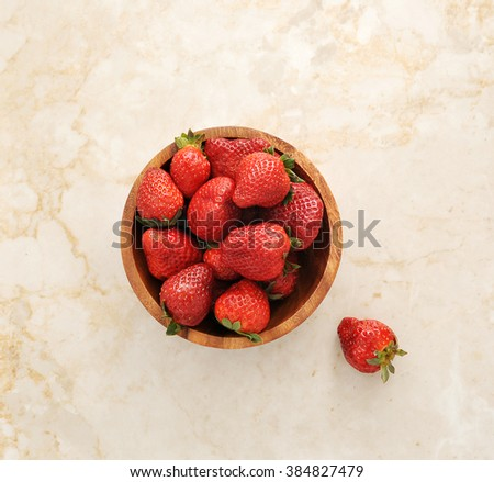 strawberries in a wooden bowl. top view - stock photo