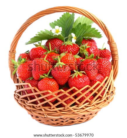 strawberries in basket with leaves and flowers