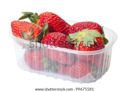 Strawberries in plastic box isolated on white.