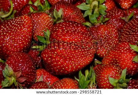 strawberries in the background.