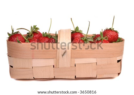 Strawberries in wooden basket isolated over white background - stock photo
