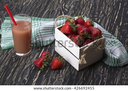 Strawberries in wooden box and juice - stock photo