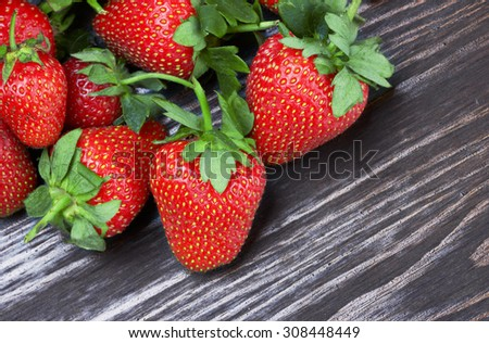 Strawberries on a wood background - stock photo