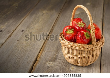 strawberries on a wooden table - stock photo