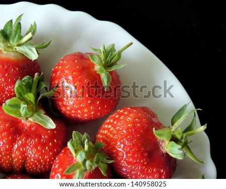 Strawberries on the plate isolated