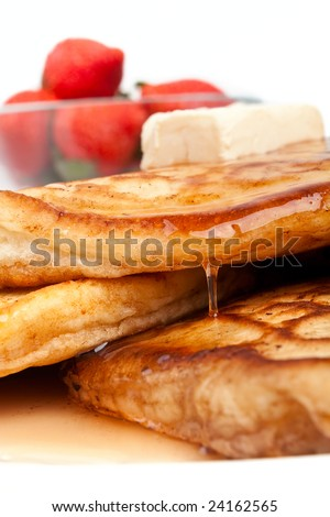 strawberries & pancakes with maple syrup and butter