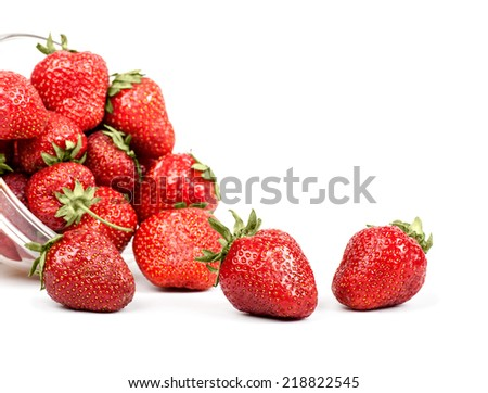 strawberries poured from transparent plates - stock photo
