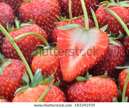 Strawberries sliced on Strawberries background
